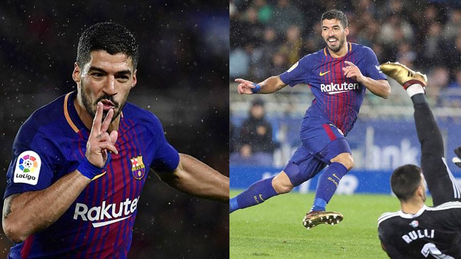 Suarez helps Barca go nine points clear