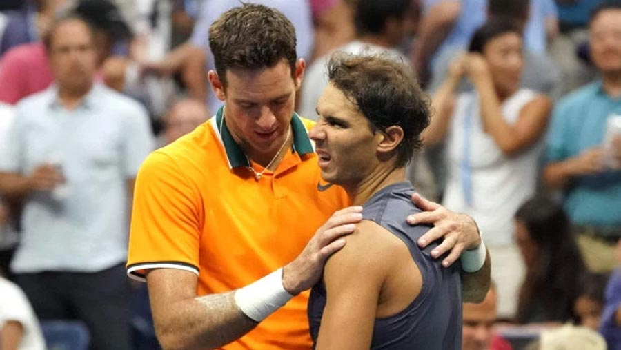 Del Potro into final as Nadal retires