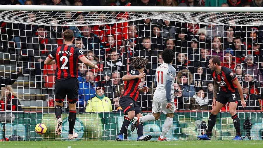 Salah hat-trick sends Liverpool to top