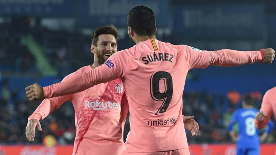 Messi and Suarez take Barca five points clear
