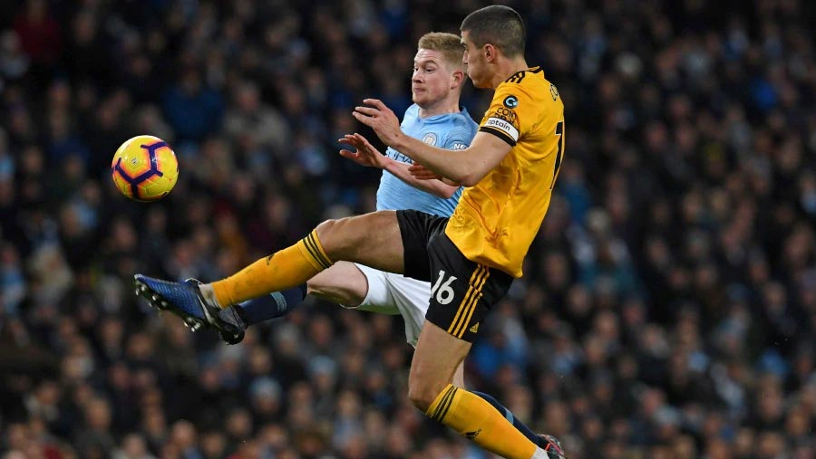 Man City ease past 10-man Wolves