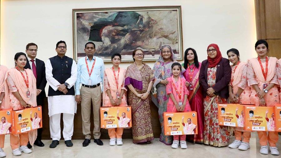 PM presents laptops, sewing machines to Shishu Paribar members