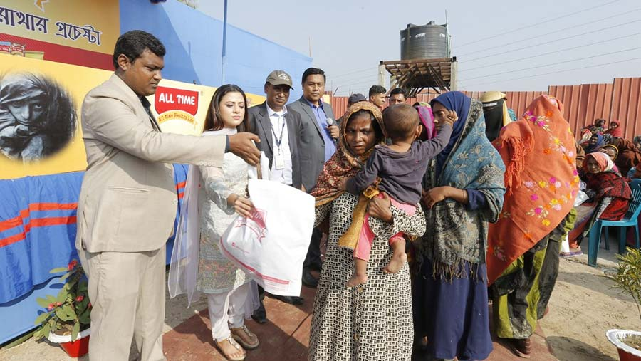 All Time distributes clothes among cold-hit people