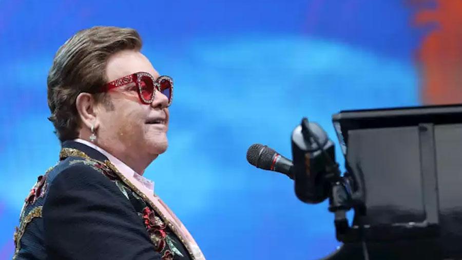 Elton John halts concert saying he can't sing