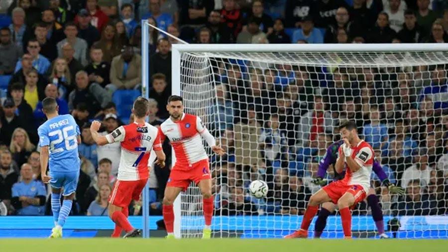 Man City overcome setback to thrash Wycombe